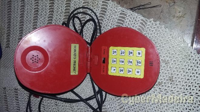 Telefone com formato de tomate