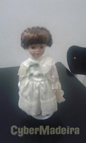 Bonecas em porcelana