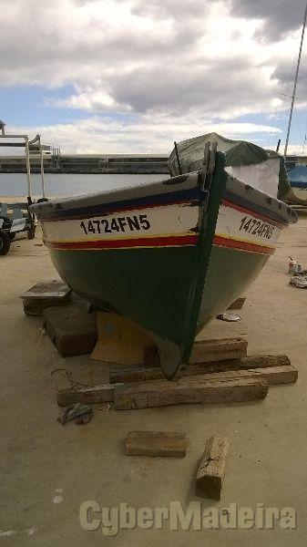 Canoa de madeira com yamaha 9.9