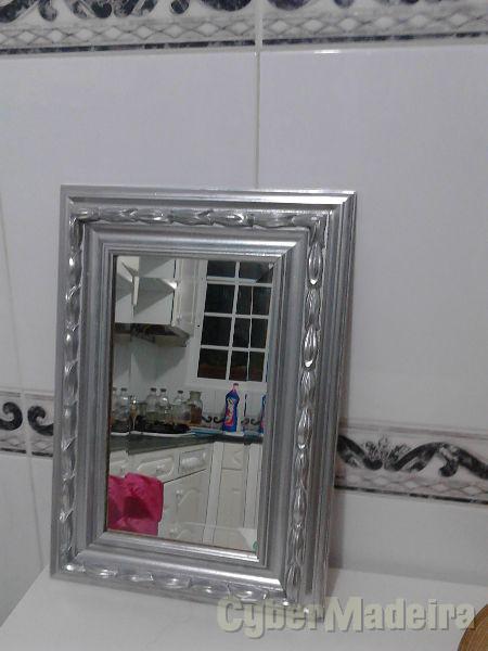 Espelho bizelado com moldura preteada